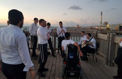 United in song facing the waves and ocean with a sick young man • Reding, Tel Aviv‏