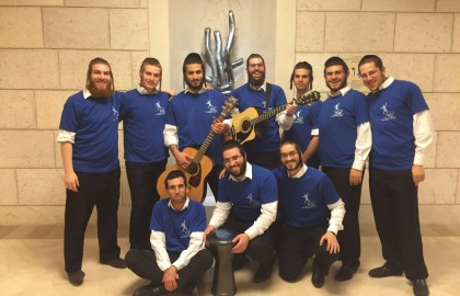 Our volunteers at the bedside of a Yeshiva Bochor in Hadassah Hospital.