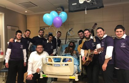 Belev Echad Volunteers bring some simcha to one of the wounded terror victims in Ofrah.